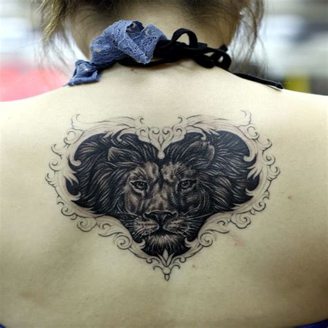 female lion tattoo designs tattoos representing strength wolf tattoos can represent