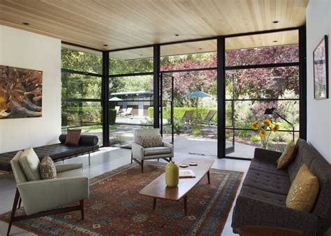 glass wall design for living room mixing up the modern renovated 1960 s house has touches of retro and vintage styling