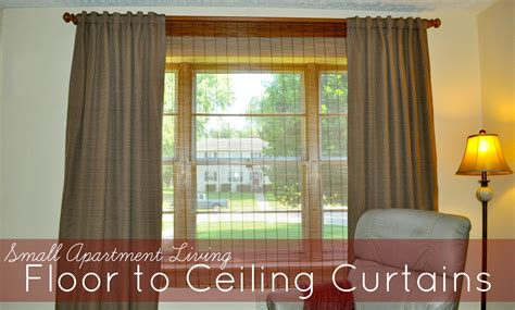small apartment living floor to ceiling curtains to the