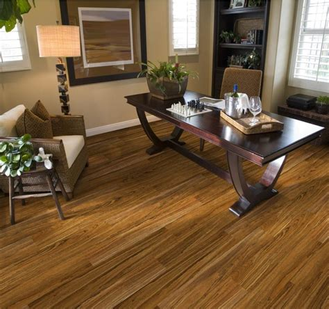 vinyl flooring living room ideas peru wooden vinyl plank flooring matched with wall with white baseboard molding plus