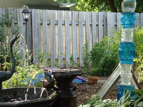 Upcycling Ideas For The Garden I M Diggin The Glass In This Totem Garden Flowers Pinterest