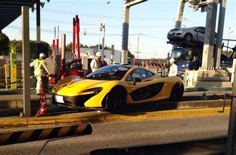 p1 crash mclaren p1 mounts curb in tollbooth crash in japan