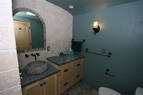 signature woodworks tuscan bathroom in eastlake above the counter bowl