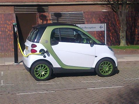 smart car green smart car white and green electric car charging aston