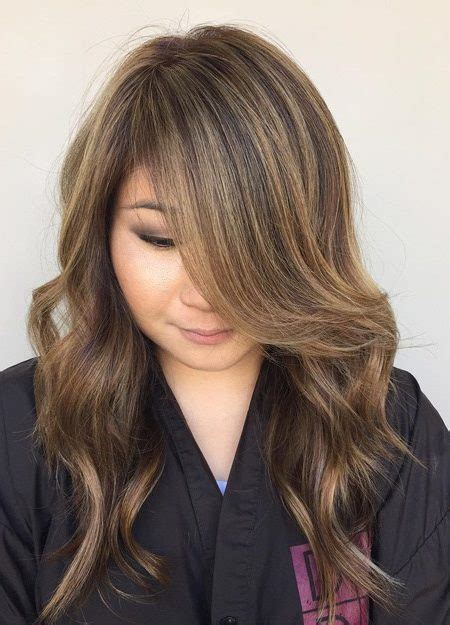 highlights for black hair and layered for ladies over 50 jaw dropping hairstyles for women for round faces