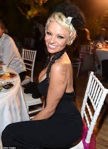 pamela anderson appears surprised by her own cleavage