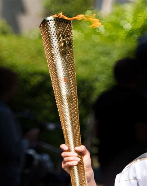 Lighting Olympic Torch by The Official Of The New York Institute Of And