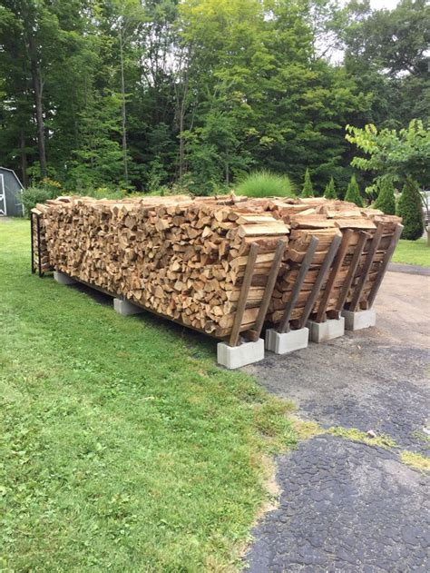 diy firewood rack cinder block firewood stacking racks holds 1 cord per row made with 3