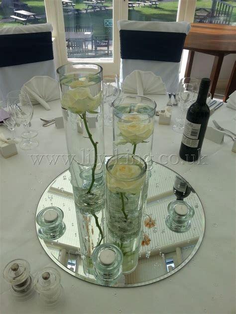 3 cylinder vases of varying heights with a white