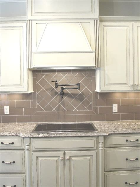 white gray glaze kitchen island with gray marble counter white glazed cabinets minka lighting bianco antico