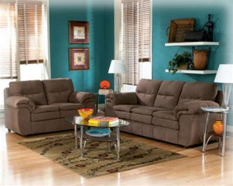 peacock colors and brown furniture great wall color for the front room flowing to the
