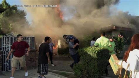 california walks into burning house and rescues