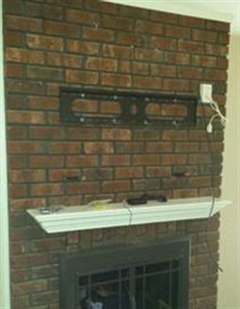 Mount Tv On Brick Fireplace by Custom Tv Mounting Brick Tv Mount Fireplace