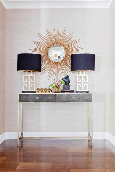 grey and gold desk gold and gray foyer features a gold sunburst mirror over a