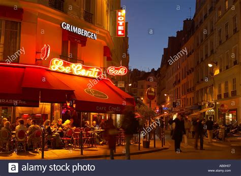street l at night pavement cafe at night on the corner of rue de buci rue de