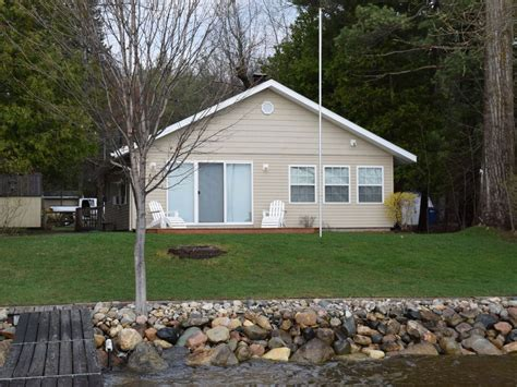 cottage rentals torch lake lakefront cottage with large boat lift rapid