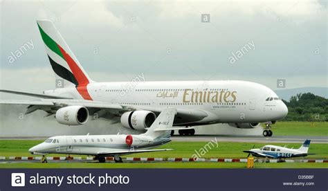 emirates private jet emirates airlines airbus a380 861 e6 edk lands on a wet