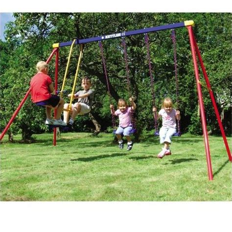 children on swing kettler deluxe multiplay swing set