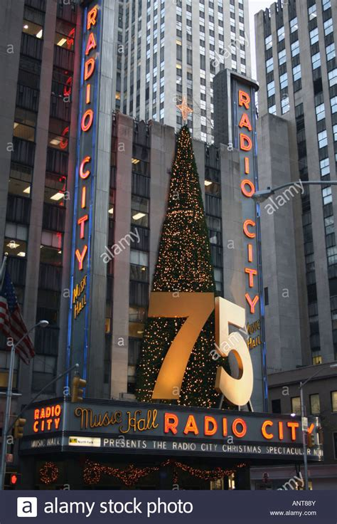 radio city christmas tree 75 year anniversary sign and tree on radio city stock photo royalty free