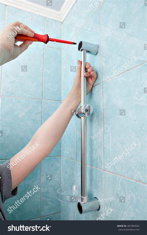 How To Tighten Shower Holder by Plumbing Repairs Bathroom Closeup Plumber Stock
