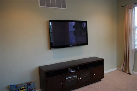 tv on the wall ideas mounted tv ideas how to decorate them beautifully homesfeed