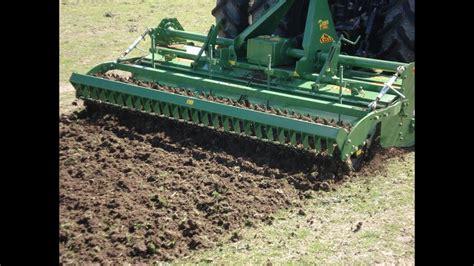 tractor john deere  celli rotary tiller  plowing