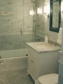 Small traditional master tub shower combo idea in boston with an