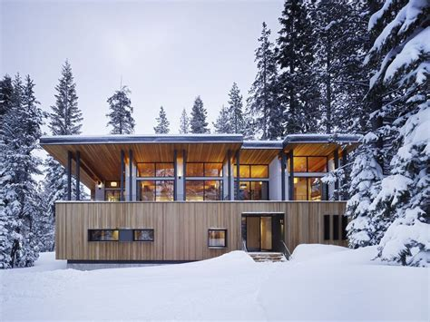 snow home modern mountain home uses railroad avalanche shed design