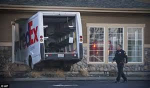 express wall fedex truck smashes through washington inn express