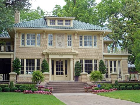 yellow brick house with tile roof swiss avenue dallas