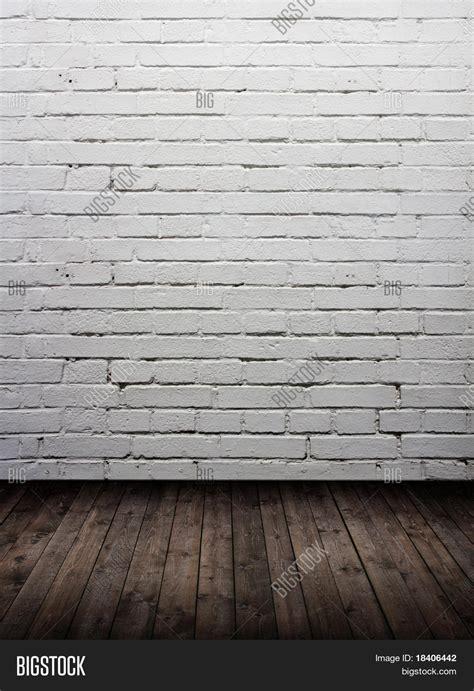 white brick wall white brick wall simple wooden shelf on white brick wall