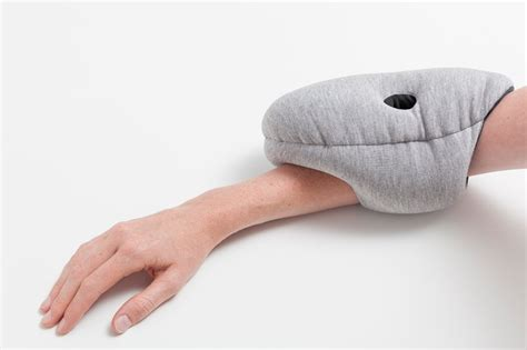ostrich pillow mini attaches to hand arm elbow for easy