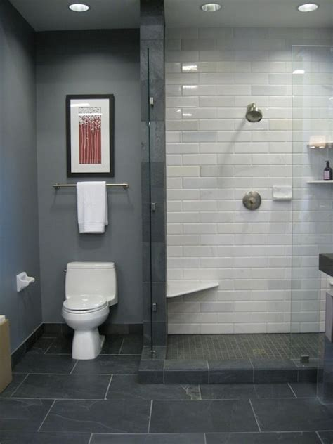 bathrooms   black slate floor, white stone subway tile in