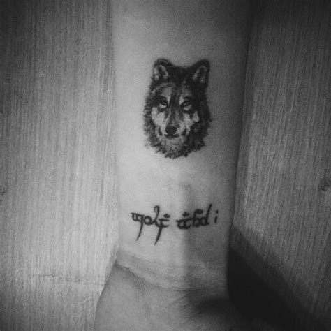 small wolf tattoo designs wolf wrist designs ideas and meaning tattoos for you