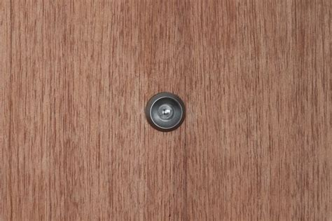 Door Eye by In Eye As He Looked Through Of His Front Door Mirror