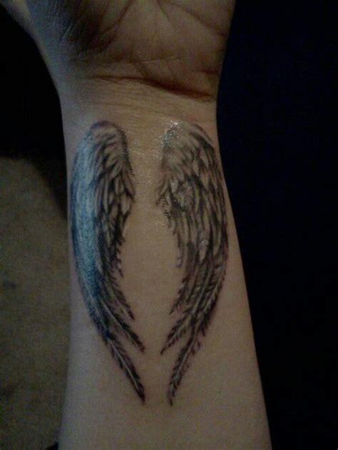 tattoo lyrics wrist angel wings tattoo on wrist ink