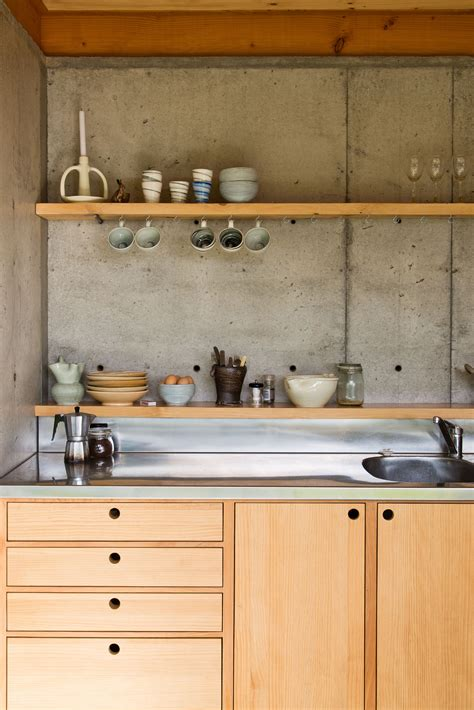 Hanging Cabinets On Concrete Walls by Concrete Slab Walls And Wooden Bench Cupboard Kitchen