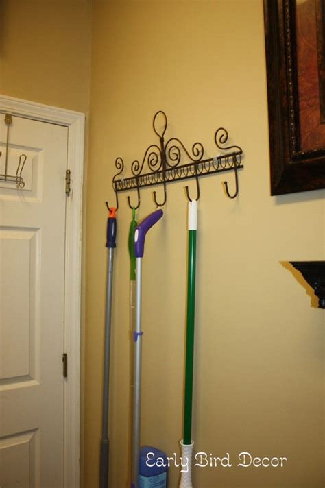 Rack To Hang Brooms And Mops by So Simple Why Didn T I Think Of This Coat Rack To Hang