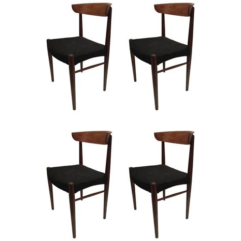 set of four modern century teak dining chairs for
