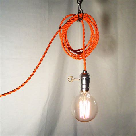 hanging l twisted orange cord exposed edison bulb