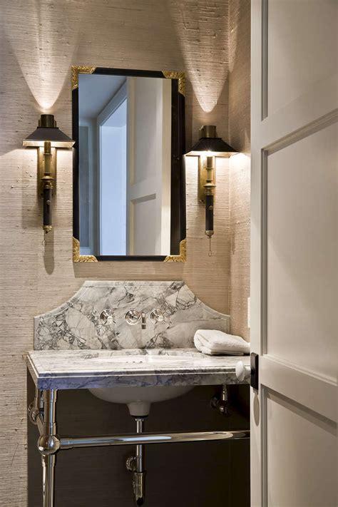 powder room vanity with curved marble backsplash