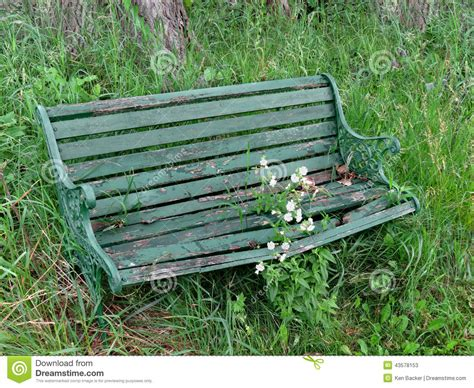 what is green bench and worn green bench in weeds stock photo image