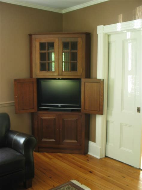 Corner Entertainment Armoire by Corner Cabinet Traditional Entertainment Centers And