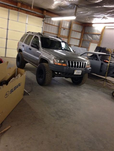 lifted jeep grand cherokee lifted grand cherokee wj on 33s jeep pinterest