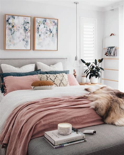 a chic modern bedroom with a white gray and blush pink