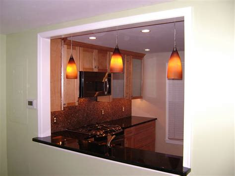window between kitchen and living room pendant lights in a newly created opening between the