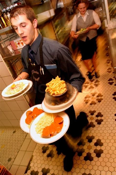 carrying food view of waiter carrying food plates stock photo colourbox