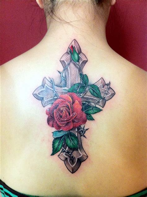 tattoos of crosses with roses cross flower ideas