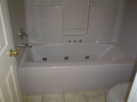 Shower Into Bathtub by Convert Jetted Tub Into Low Maintenance Shower Cleveland
