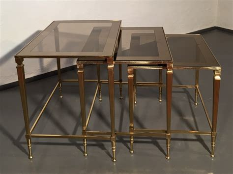 brass and glass nesting tables brass mirrored glass nesting tables by maison